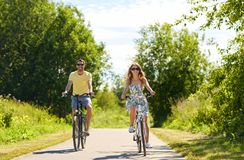 Happy young couple riding bicycles in summer stock photography