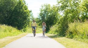 Happy young couple riding bicycles in summer stock photos