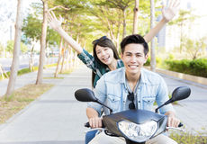 Happy young couple riding  scooter in town Royalty Free Stock Photo