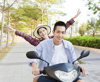 Happy young couple riding  scooter in town Stock Photo