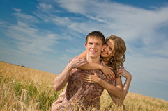Loving couple on wheat field Stock Photography