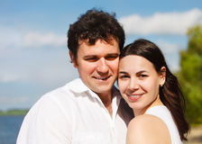 Happy young couple on the river coast Stock Photo