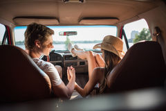 Couple holding hands in car Stock Images