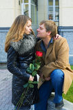 Happy young couple with roses. Stock Photos