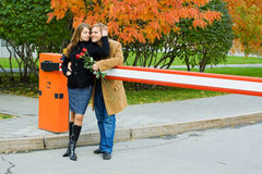 Happy young couple with roses. Stock Photography