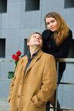 Happy young couple with a roses. Stock Photo