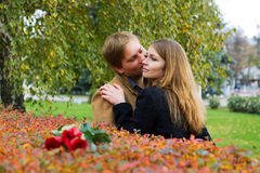 Happy young couple with a roses. Royalty Free Stock Photos
