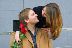 Happy young couple with roses. Royalty Free Stock Photo