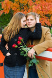 Happy young couple with roses. Royalty Free Stock Photography