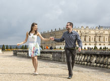 Happy Young Couple Running Holding Hands Royalty Free Stock Images