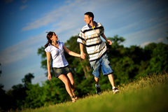 Happy young couple running outdoor Royalty Free Stock Photo