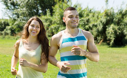 Happy young couple running outdoor Royalty Free Stock Image