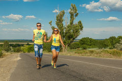 Happy young couple running Royalty Free Stock Images