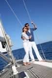 Happy young couple on a sailing boat Stock Images