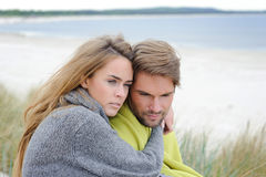 Happy young couple in sand dune having fun. Family Outdoors - autumn, warm clothes, beach Stock Photo