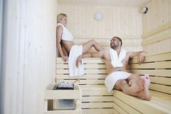 Happy young couple in sauna Royalty Free Stock Photos