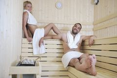 Happy young couple in sauna Royalty Free Stock Image
