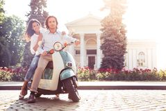 Happy young couple on scooter Stock Images
