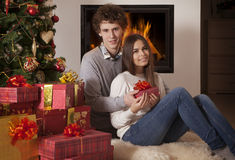 Happy young couple sharing gift Royalty Free Stock Photo