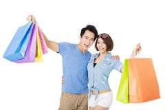 Happy young Couple with shopping bags Stock Photos