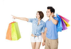 Happy young Couple with shopping bags Royalty Free Stock Photo