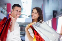 Happy young couple in shopping Stock Photography
