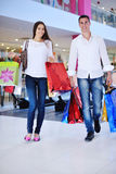 Happy young couple in shopping Stock Images