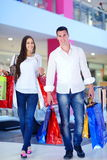 Happy young couple in shopping Royalty Free Stock Photo