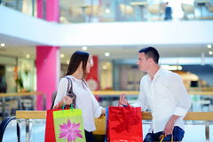 Happy young couple in shopping Royalty Free Stock Photography