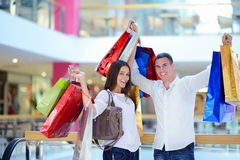 Happy young couple in shopping Royalty Free Stock Images