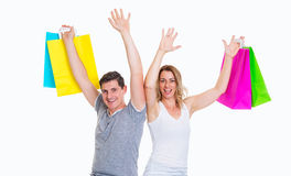 Happy young couple with shopping bags Royalty Free Stock Images