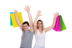 Happy young couple with shopping bags. In front of white background Royalty Free Stock Photo
