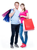 Happy young couple with shopping bags. Royalty Free Stock Photography