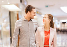 Happy young couple with shopping bags in mall Royalty Free Stock Photo