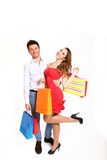 Happy young couple with shopping bags  on white bacgkrou Royalty Free Stock Images
