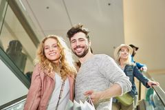 Happy young couple shopping royalty free stock photos