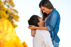 Happy young couple showing affection. Stock Photos