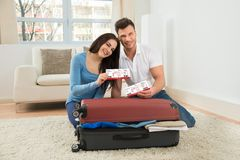Happy young couple showing boarding pass Stock Images