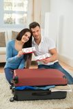 Happy young couple showing boarding pass Royalty Free Stock Image