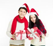 Young couple showing christmas gifts Stock Images