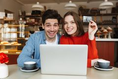 Free Happy Young Couple Showing Credit Card Stock Image - 119954401