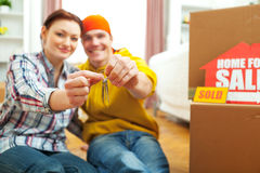 Happy young couple showing home keys Stock Image