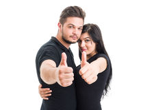 Happy young couple showing like Royalty Free Stock Image