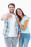 Happy young couple showing new house key Royalty Free Stock Image