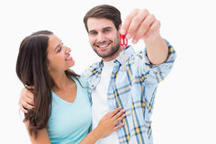 Happy young couple showing new house key Royalty Free Stock Photos