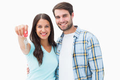 Happy young couple showing new house key Royalty Free Stock Photography