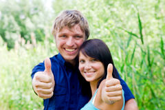Happy young couple showing thumbs Royalty Free Stock Image