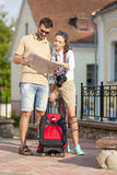 Happy Young Couple Sightseeing Places With Map. Vertical Image Composition Stock Photo