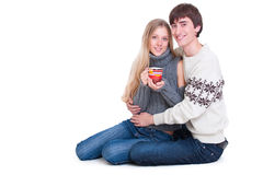 Happy young couple sitting on the floor royalty free stock image