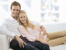 Young couple relaxing on sofa royalty free stock image